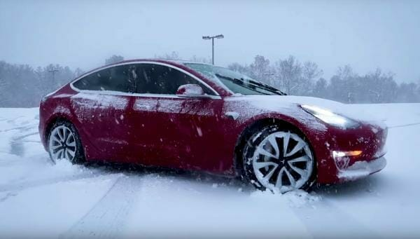 tesla model 3 in snow