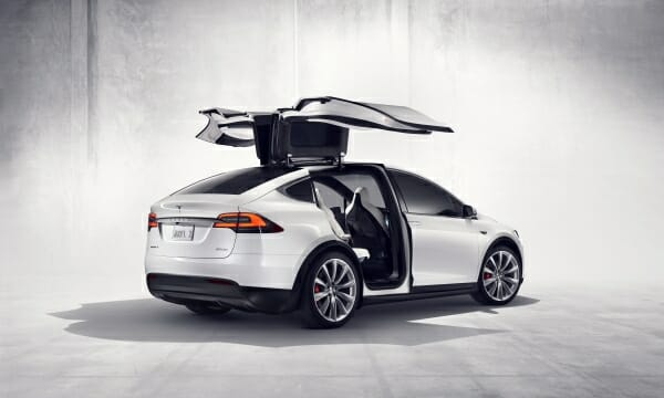 white Tesla Model X with falcon wing doors