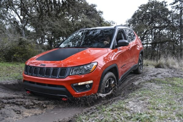 red 2019 Jeep Compass in mud